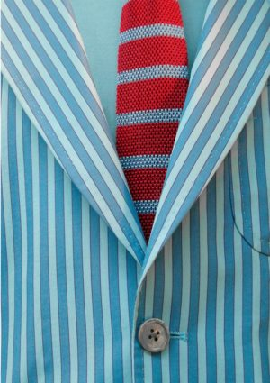 Bleed in printing illustrated with a greeting card featuring a blue and white striped jacket and red and blue tie.