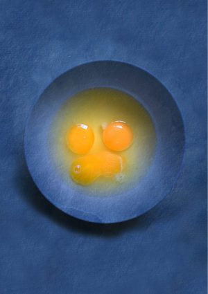 A Yolks Greeting Card for every day featuring a blue bowl filled with egg yolks against a blue background.
