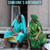 Two women in Rajasthan and text 'Someone's Birthday?'