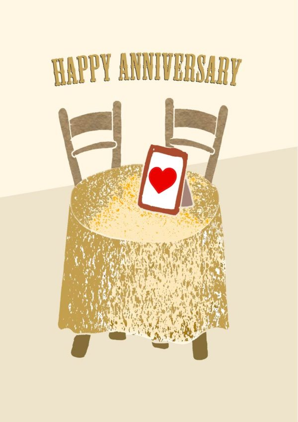 A dressing table with a photo frame with hearts and text 'Happy Anniversary'