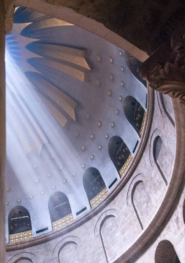 The dome of the Church Of The Holy Sepulchre in Jerusalem looking up with light coming through the oculus