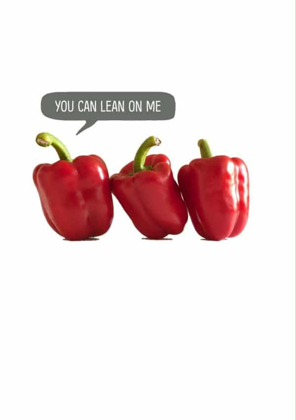 three red peppers leaning on one another and speech bubble and one of the peppers saying 'You Can Lean On Me'