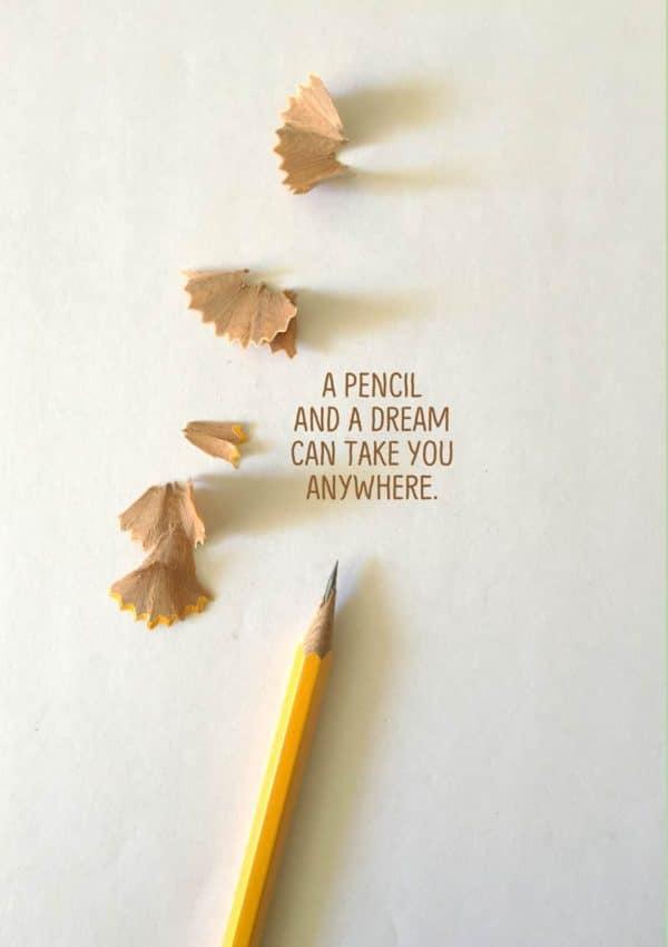 Pencil Dreams - a pencil and shavings that seem to be flying away and text 'A Pencil And A Dream Can Take You Anywhere'