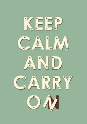 An inspirational greeting card with the well-known statement to 'Keep Calm And Carry On', except that in this case the message is in want of repair. The last letter is hanging on by a screw, and one screw has come adrift.