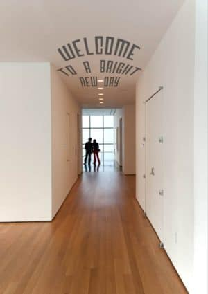 A couple in silhouette in a modern building and text 'Welcome To A Bright New Day'