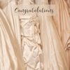Wedding gowns on a rack and text 'Congratulations'