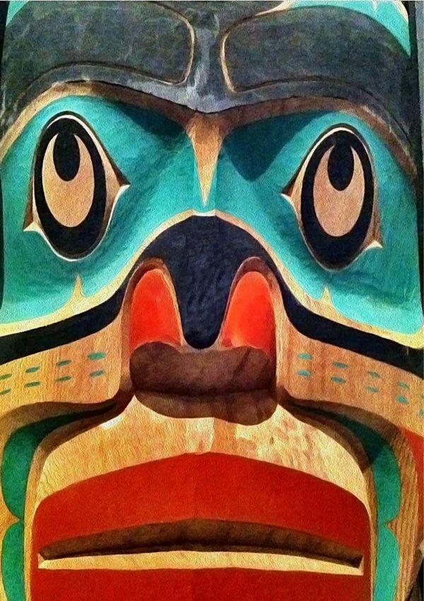 A carved Inuit face in red, green, blue and natural wood