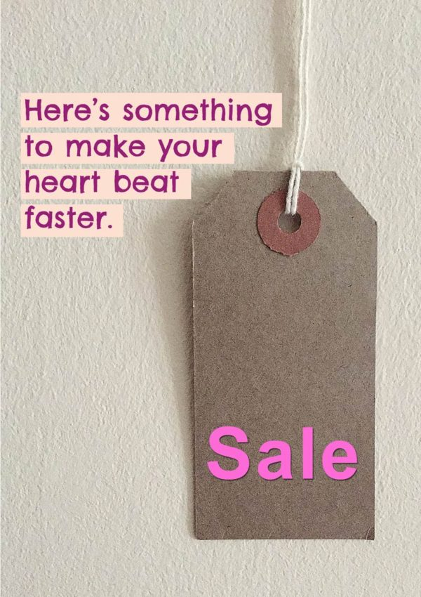 A sales swing tag with the word 'SALE' on it and text 'Here's Something To Make Your Heart Beat Faster'
