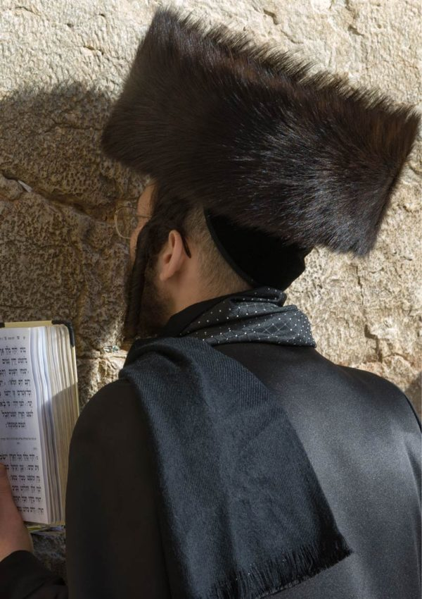 An inspirational greeting card with a man wearing a fur hat or shtreimel praying at the Western Wall in the Old City of Jerusalem