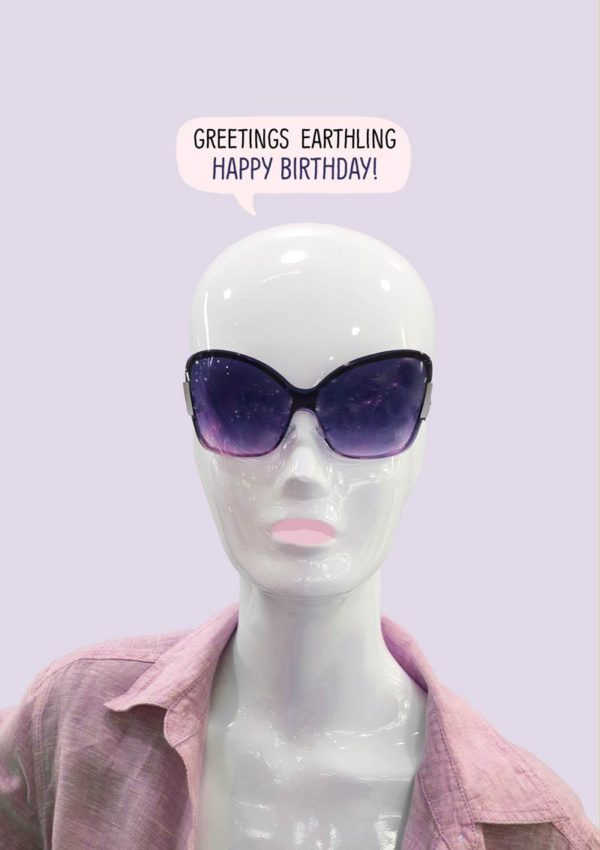 A birthday card featuring an alien in a pink shirt with sunglasses and a somewhat alien head, and a speech bubble with text 'Greetings Earthling - Happy Birthday'