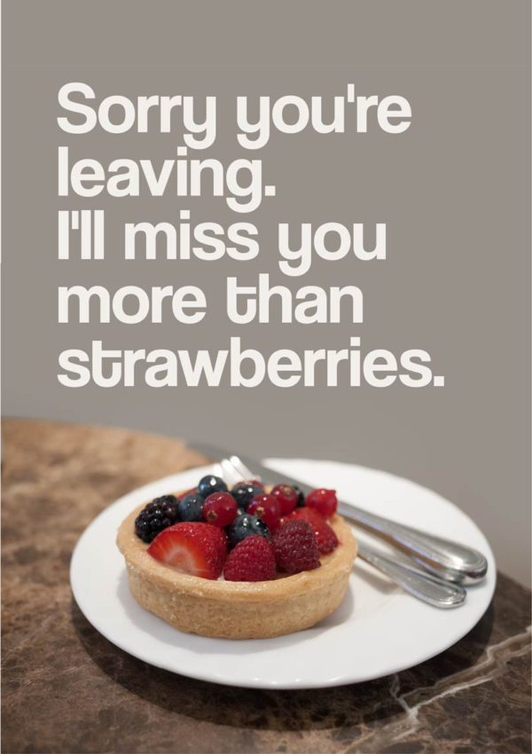A fruit tart on a white plate with knife and fork and text 'Sorry You're Leaving. I'll Miss You More Than Strawberries'
