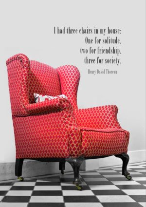 A red, wing-backed chair on a tiled floor and text - a quotation from Henry David Thoreau 'I had three chairs in my house: One for solitude, two for friendship, three for society.'