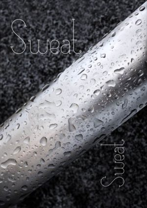 A light-coloured metal bar with droplets of water on it set against a granite background with text 'Sweat' repeated twice.