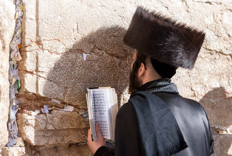 Prayers on scraps of paper in gaps in the walls of the Western Wall in Jerusalem