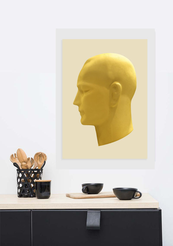 Thinking head poster in situ on a wall in a living room with cups and crockery on a table