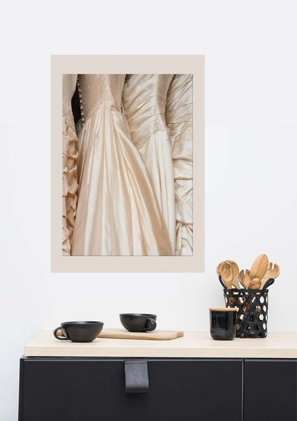 Wedding Dresses poster in situ on a wall in a living room with a sideboard and crockery